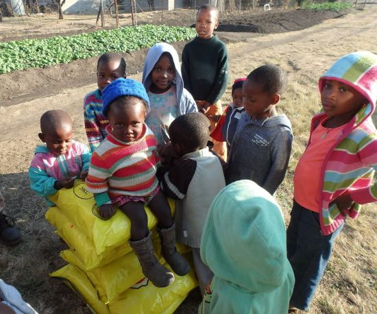 The Lesotho Orphans happy with food just brought in!