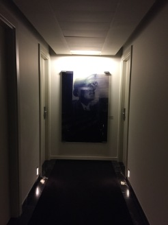 Not a great picture but an outhor is depicted on every floor.